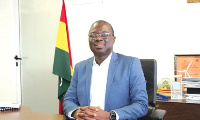 Mr Kofi Ellis and the leadership of Punctuality Ghana Foundation after signing punctuality pledge