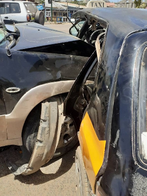 The taxi driver is reported dead whiles the Mazda tribute car driver is receiving treatment