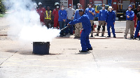 The team taking drills on how to douse fire