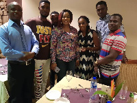 Empress Gifty Osei with some management members and bloggers