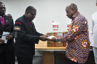 The Ministry of Health received a Cheque for GHC20,000 and 100 gallons of hand sanitisers