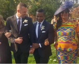 Stephen Kabutey holding hands with his gay partner and being accompanied by his mother.
