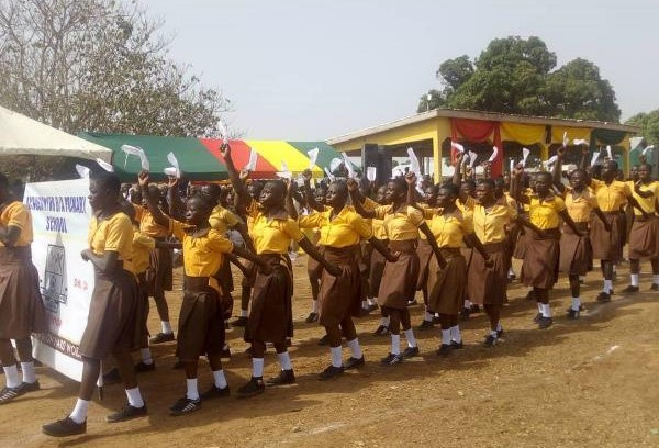 Some of the school children marching
