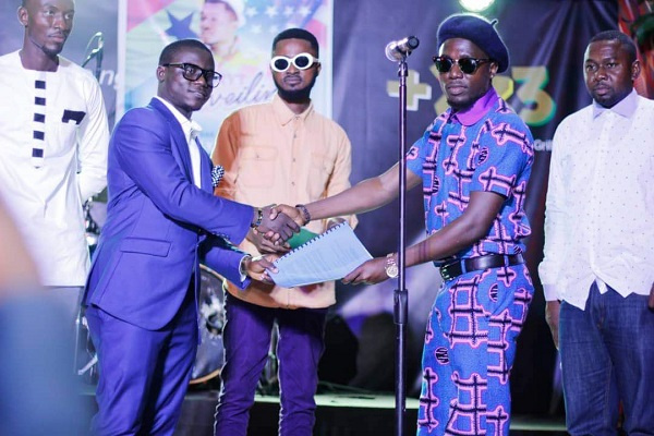 B-RYT on stage with his new management