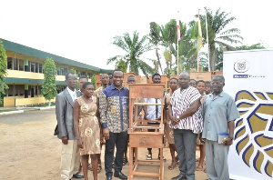 Officials of Gold Fields Ghana in a shot with beneficiaries