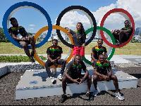 Ghana's athletics team pose with the Olympics logo at their base