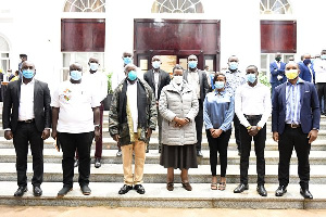 President Museveni, wife (c) posing with a group of youth whose Facebook account were closed