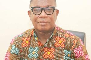 Dr Michael Tanu, Director-General of the GMet