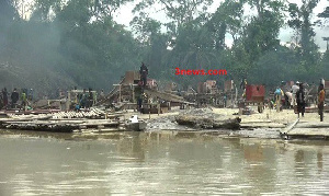 Illegal small scale miners busily prospecting for gold from the Pra River