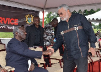 Former President Rawlings (r) in a handshake with Former President Kufuor (l)