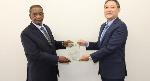 Director of the company, Mr Hiroshi Hirata receiving an award from Mr. Frank Okyere