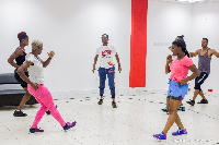 Coach Bino engages some Airtel employees in a workout session