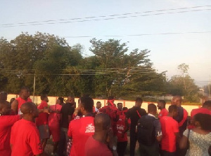Residents clad in red hit the streets to put pressure on government to complete the footbridges