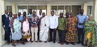 The NHIA team in a group photograph with members of the Oguaa Traditional Council