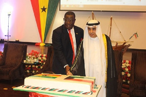 Ambassador Mohammed Abdullah Alkhaledi with Kwasi Amoako Atta cutting cake