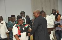 The President applauding Jewel Ackah, one of the recipients of the awards.