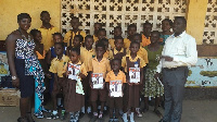 Ms. Wendy Brown Derns (L) in a group photograph with the school children and teachers