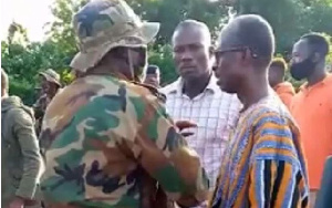 Asiedu Nketia, General Secretary of NDC (R) in a discussion with the military men at Banda