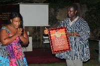 Deborah Dabor Benjamin, philanthropist presenting the citation to Nana Asaase