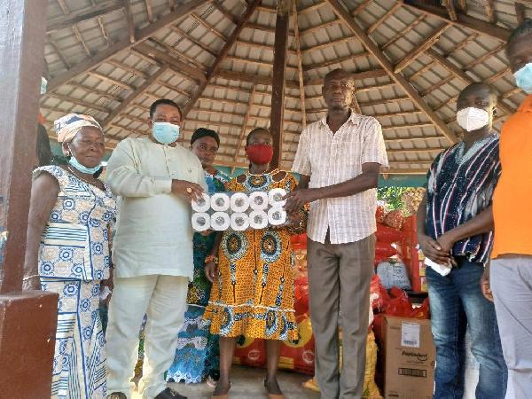 Nana Appiagyei Dankawoso I, presenting some items to the orphanage home leaders