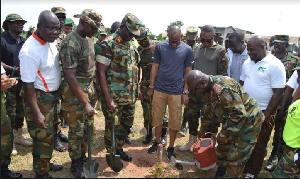 Major General William Azure Ayamdo watering the tree