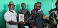Aminu Chinnia Issshaku receiving his forms