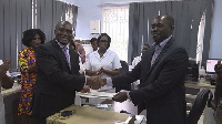 Eric Opoku (R) presenting the handing over notes of the donation to Dr. Anaab-Bisi