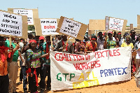 Some members of the Coalition of Textile Workers demonstrating on the streets of Accra