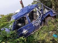 The mangled police vehicle after the crash