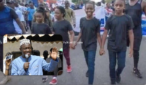 The children of the late Agyarko hold hands during a political campaign