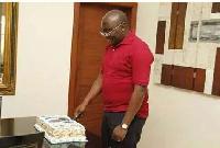 Dr Mahamudu Bawumia cutting his birthday cake
