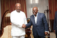 President Nana Addo Dankwa Akufo-Addo in a handshake with Former President John Dramani Mahama