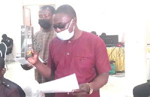 The two taking their oaths when they appeared before the PAC in Sunyani