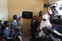 Richard Nii Armah Quaye unveiling the plaque of Quick Angels with John Kumah