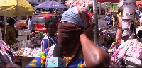 A Makola market trader ties her whole face with a handkerchief due to the fear of coronaviirus