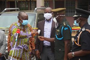 Ashanti Regional Minister, Simon Osei Mensah handing over keys to the vehicles to GAF