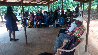 P4H official speaking to some residents within Lower Manya Krobo