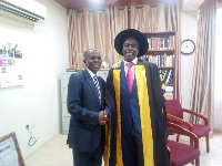 Executive Chairman of Radford University, Nana Dwomoh Sarpong(R) in a handshake with Dr. Effah