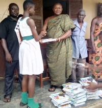 Hon Pius Opoku presenting the materials to the pupils