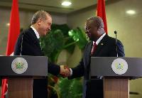 Turkish President Erdogan (left) in a handshake with Prez Mahama