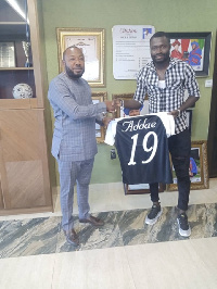 Bright Addae presenting a signed jersey to Kwame Kyei Peprah