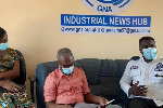 Tema Regional MTTD Chief Supt William Asante (right) speaks during a meeting at GNA offices
