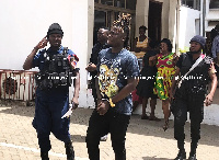 Wisa Greid being led away after he failed to pay the fine and also meet the bail term