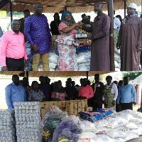 Mrs Adwoa Amoako presenting items to the Muslim communities within Tema West Municipality