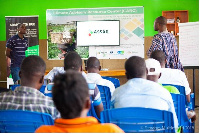 Prince Ansah, a technical officer introducing farmers to Climate Advisory Center