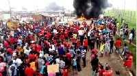 The angry demonstrators burn tyres in front of the office (File photo)