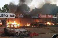 Shops belonging to foreign nationals are allegedly being looted by South Africans