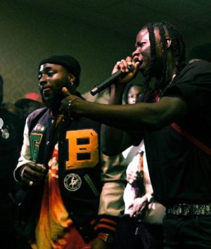 Nigerian musician, Davido and Ghana's Stonebwoy on stage