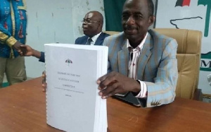 NDC's General Secretary, Johnson Asiedu Nketia receiving the Kwest Botchwey report