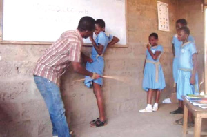 A teacher caning pupils | File photo